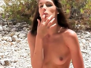 Beautiful leggy brunette with small tits masturbating outdoors
